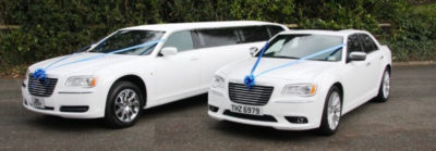White Chrysler Limo and saloon pair